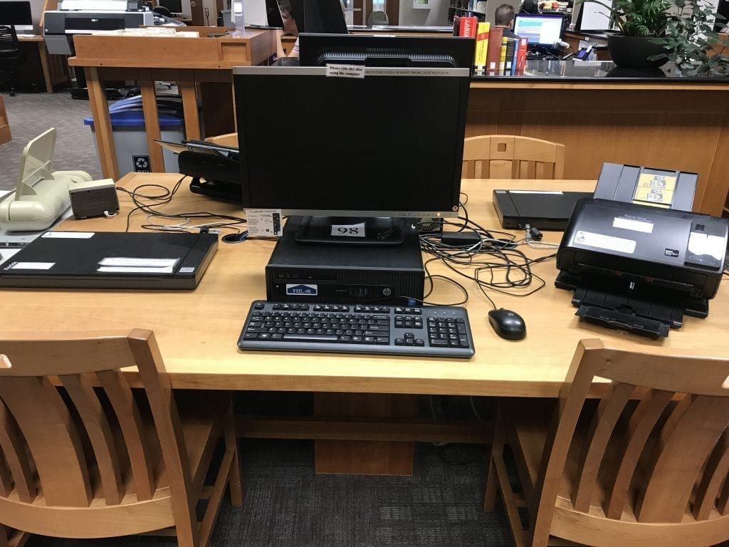 A batch feed photo scanner available for free use at a nearby library